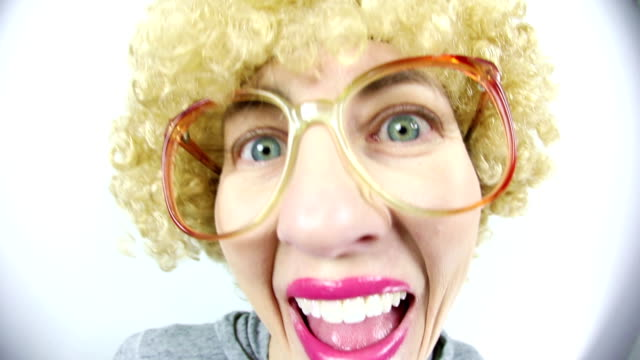 fisheye happy geek with blond afro wig - fish eye video stock e b–roll