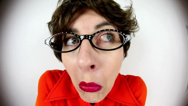 Fisheye Terrified Nerdy Woman A fisheye video clip of a frightened nerdy woman. shivering stock videos & royalty-free footage