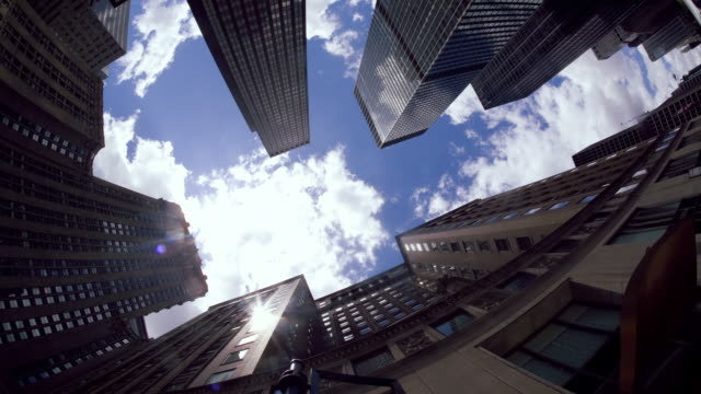 Fisheye Time lapse of towering office buildings and clouds video