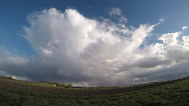 Fisheye view of a typical april shower over the dutch landscape Movement of an april shower with hail shaft over the wide open landscape of The Netherlands. anvil stock videos & royalty-free footage