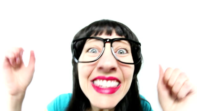 Fisheye Woman Reacting to Exciting News Fisheye video footage of woman in big nerd glasses with long black hair who is really excited about something. good news stock videos & royalty-free footage