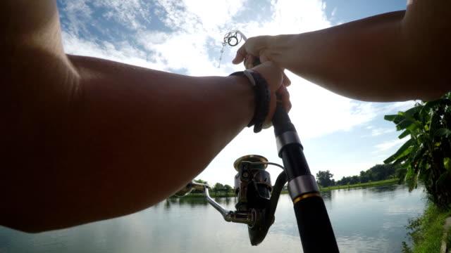 4K POV fishing big fish in lake. 4K POV fishing big fish in lake. Chao Phraya giant catfish, Chiang Mai, Thailand. fishing rod stock videos & royalty-free footage