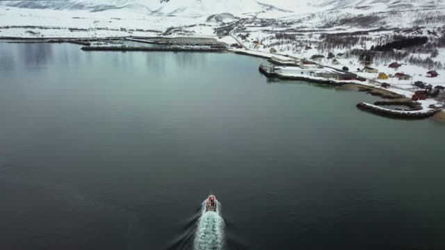 fishing boat coming back to the harbor in the northern norway - fiordi video stock e b–roll