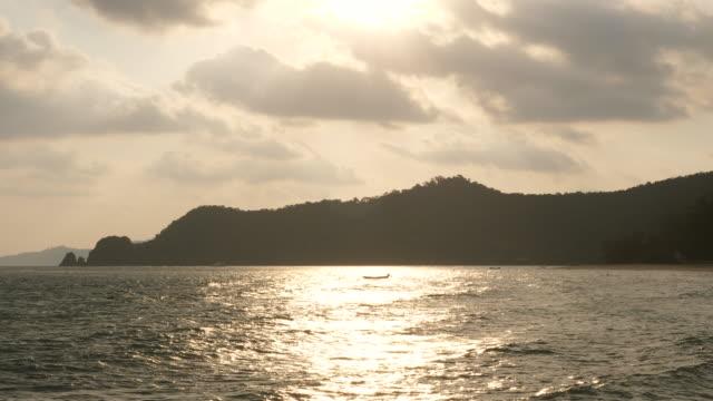 Fishing Boat in Sea with Beautiful Sunlight