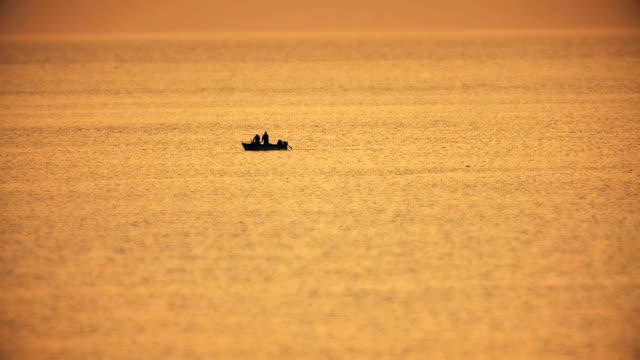 fishing boat in sunset sea - oman video stock e b–roll