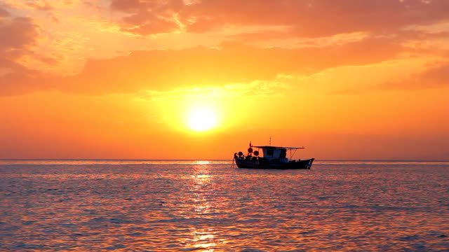 Fishing boat in the sunset video
