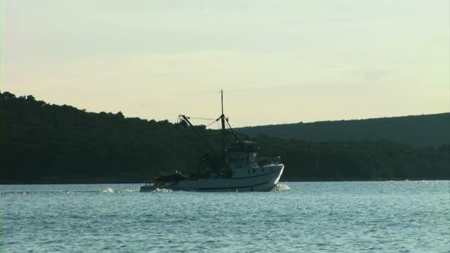 Fishing boat sailing in sea video