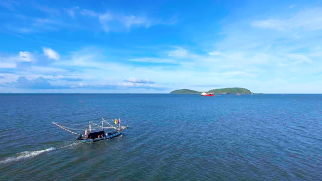 Fishing Boat Sailing in Sea with Blue Sky Day, Aerial Video Fishing Boat Sailing in Sea with Blue Sky Day, Aerial Video towing stock videos & royalty-free footage