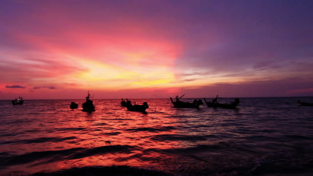 Fishing Boat silhouette in twilight sunset time with sunlight reflection at Nai yang beach, Phuket, Thailand destination 4K footage video video