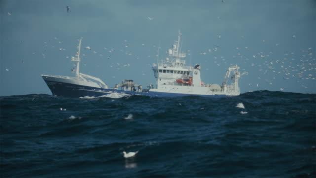 Fishing boat trawler sailing a rough North Sea