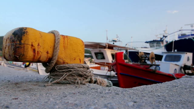 Fishing boats are tied with rope for the pier, wharf close-up at marina video