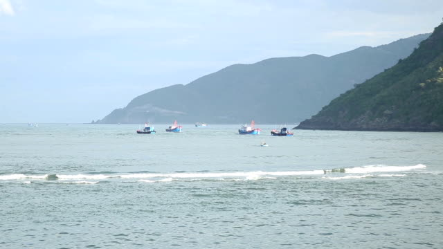 fishing boats floating on the sea fishing boats floating on the sea grooved stock videos & royalty-free footage