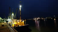 istock Fishing boats in the harbor from Lauwersoog in the Netherlands by night 1320160613