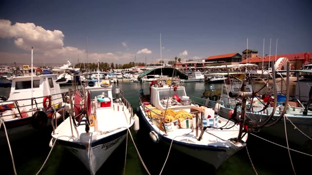 fishing boats near the pier, boat parking, Parking of fishing ships, Pleasure boats and fishing boats in harbor video