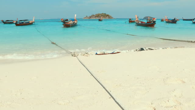 Fishing Boats on Blue Turquoise Beach video