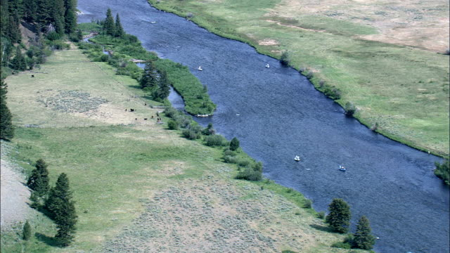 Fishing Boats On Madison River  - Aerial View - Montana,  Madison County,  helicopter filming,  aerial video,  cineflex,  establishing shot,  United States video