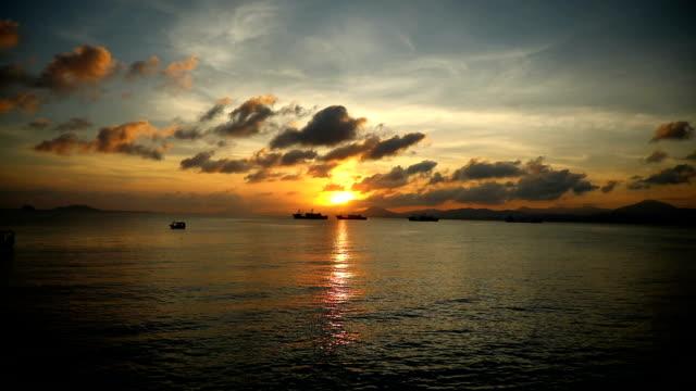 Fishing boats on sea in sunset lights in Sanya, Hainan, China