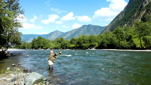 Fishing by flyfishing on the river. Russia Siberia. River Chelushman video