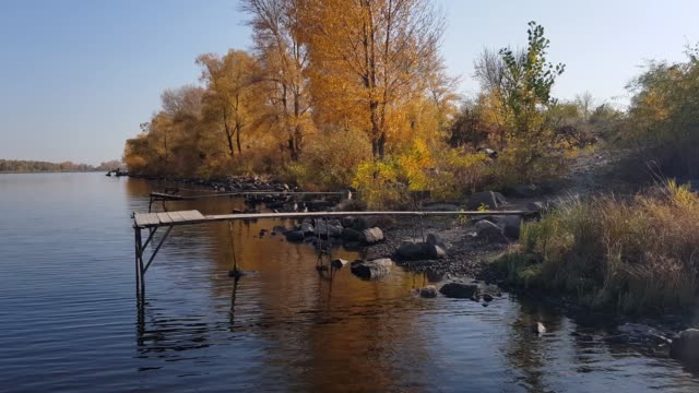 Fishing pier on the river. video