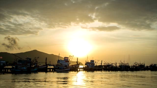 fishing port at sunset, time lapse video