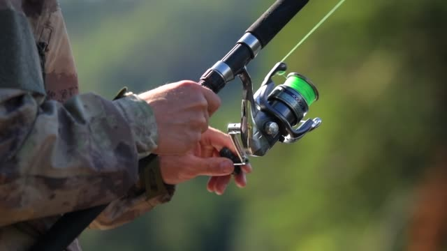 fishing rod in action. slow motion footage. fly fishing. - trout video stock e b–roll