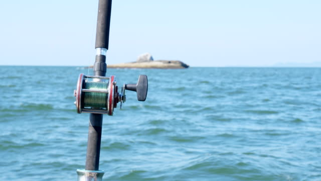 Fishing Rods on Ocean with Island Background Fishing Rods on Ocean with Island Background fishing rod stock videos & royalty-free footage