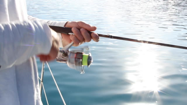 Fishing Tranquil Fishing from a boat with sun stars & calm surface life balance stock videos & royalty-free footage