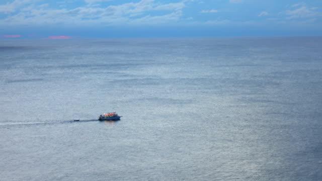 fishing-trawler boat in ocean - rimorchiatore video stock e b–roll