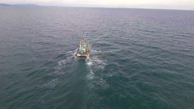 Fishing-Trawler Boat in Ocean with Drone. Fly approach shot. video