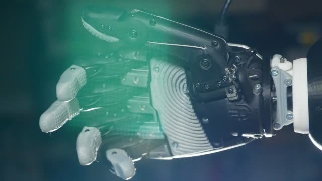 Fist of a bionic hand is squeezing Fist of a bionic hand is squeezing. 4K robot stock videos & royalty-free footage