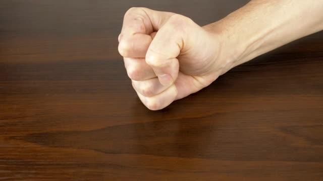 fist on the table. - colpire con un pugno video stock e b–roll