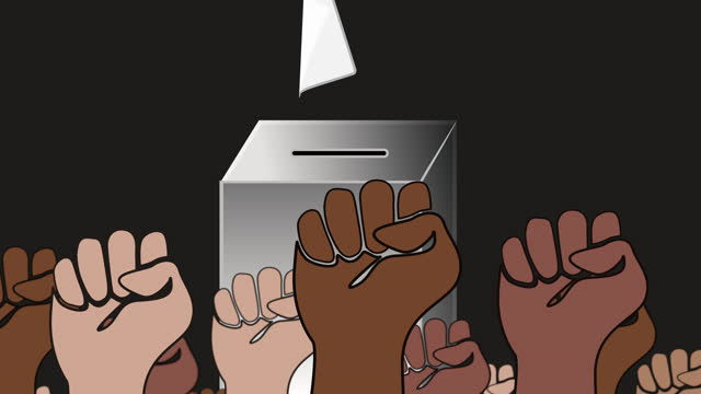 Fists of voters from different cultures in front of a ballot box