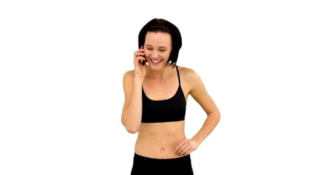 dopasowanie brunette rozmawia przez telefon - biustonosz sportowy filmów i materiałów b-roll