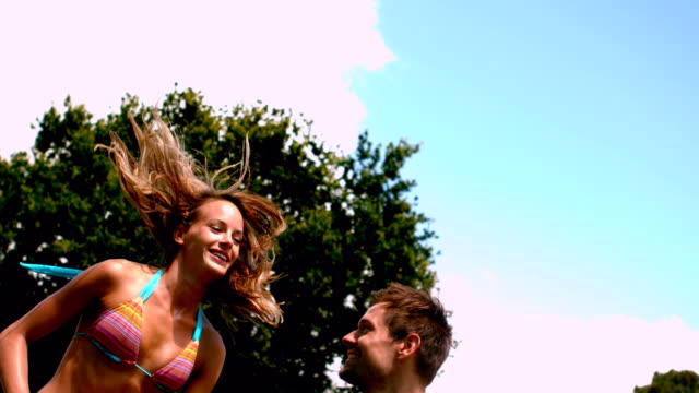 stockvideo's en b-roll-footage met fit couple in swimsuits jumping up and down - mid volwassen mannen
