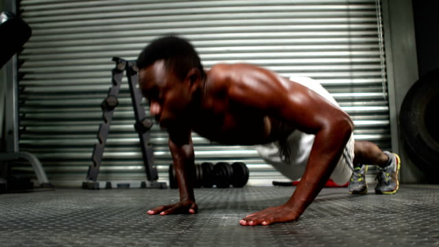 Fit man doing push ups Fit man doing push ups at the gym bodyweight training stock videos & royalty-free footage