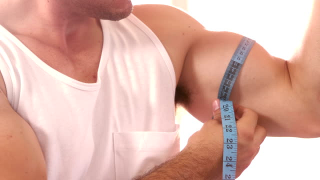 Fit man measuring his bicep video