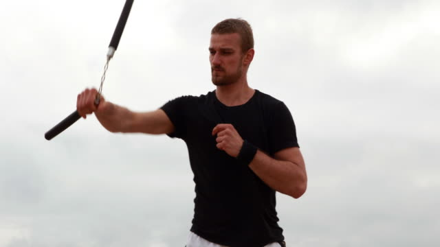 Fit man practicing martial arts video