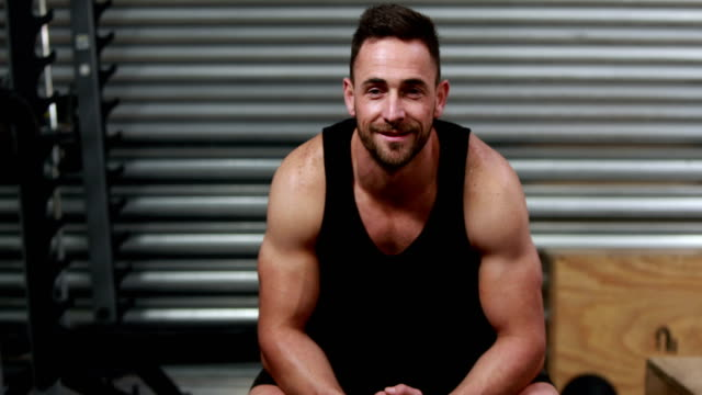 Fit man smiling and showing thumb up video