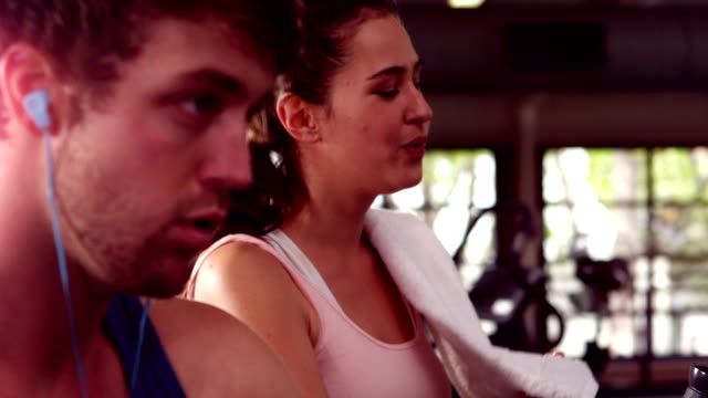 Fit people doing exercise with elliptical machine Fit people doing exercise with elliptical machine in cross train stepping stock videos & royalty-free footage