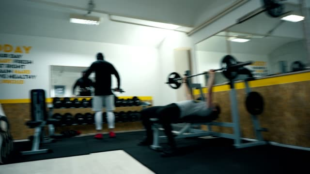 Fit people working out in the gym