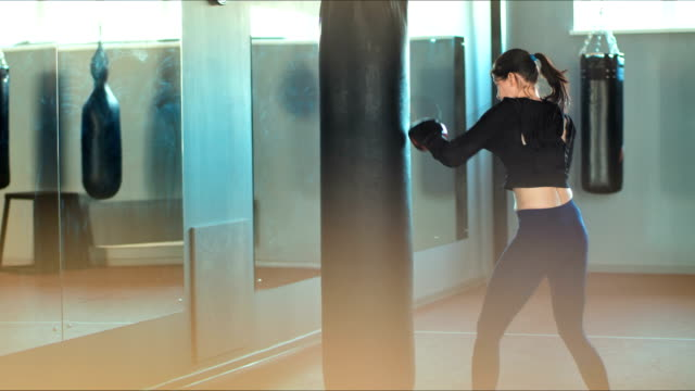 Fit Slim Young Beautiful Brunette Woman Boxing In The Gym Video