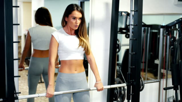 Fit woman in gym training video
