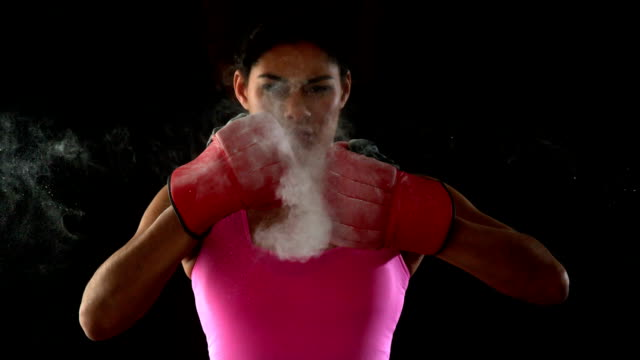 Fit woman in pink punching fists together video