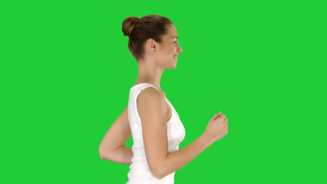 Fit young woman running on a Green Screen, Chroma Key