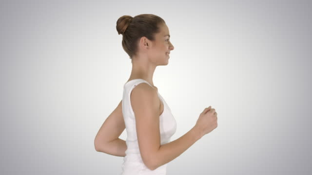 Fit young woman running on gradient background video