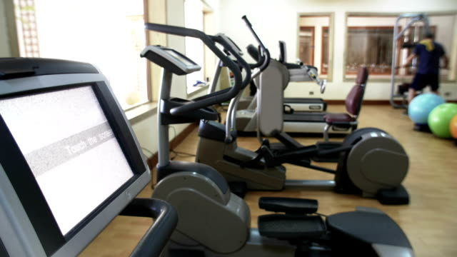 Fitness center with exercise machines video