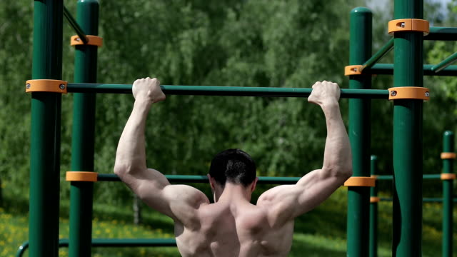 Fitness male doing pull ups. video