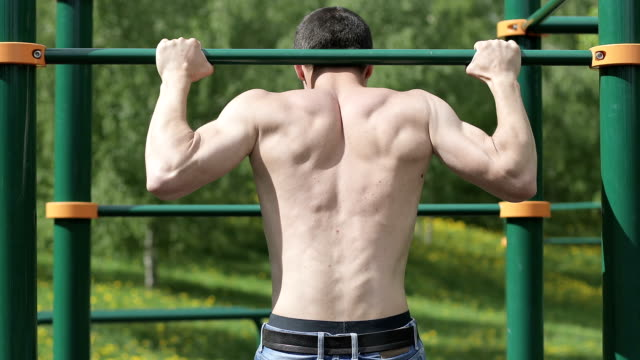Fitness man doing pull ups. video