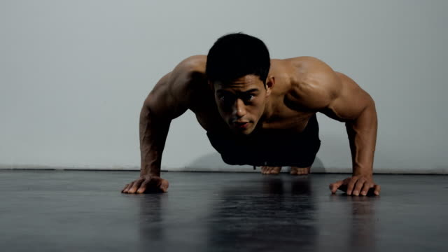 A Fitness Model Doing Push Ups video