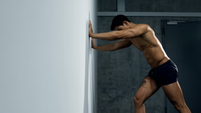 Fitness Model Leg Exercise by Pushing Up Against a Wall video
